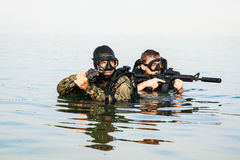 Navy SEAL frogmen. With complete diving gear and weapons in the water Stock Photography