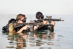 Navy SEAL frogmen. With complete diving gear and weapons in the water Royalty Free Stock Photo