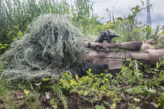 Navy Seal Sniper. With rifle in action Stock Photos