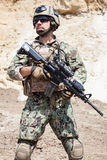 Navy SEAL team. Member of Navy SEAL Team with weapons in action Stock Image