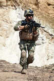 Navy SEAL team. Member of Navy SEAL Team with weapons in action Royalty Free Stock Image