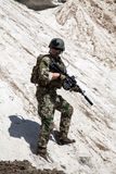 Navy SEAL team. Member of Navy SEAL Team with weapons in action Stock Images