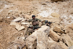 Navy SEAL Team. Members of Navy SEAL Team with weapons in action Royalty Free Stock Images