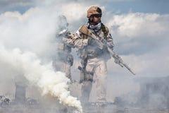 Navy Seals i handling arkivbild