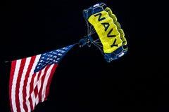 A Navy SEALs parachutes into Reser Stadium Stock Photos