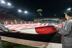 A Navy SEALs parachutes into Reser Stadium Stock Images