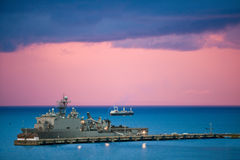 Navy ship. Navy shit pulled up at dock in beautiful evening light Stock Image