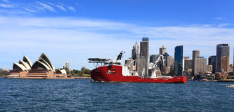 Navy Ship Ocean Shield and Sydney Opera House Royalty Free Stock Photo