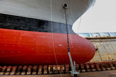 Navy ship repair. Gray color navy ship on dry dock for maintenance and repair royalty free stock image
