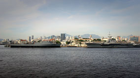 Navy ships in port. Aircraft Carrier. Dock landing ship Stock Photography