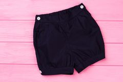 Navy shorts on pink background Stock Photo