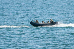Navy speed boat attack Stock Photography