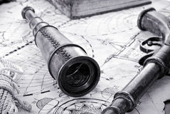 Navy still life. Still life of a navy theme - old spyglass, retro gun and sailor rope on vintage map Stock Images