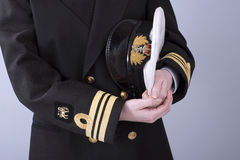 Navy uniform cap and jacket with gold braid. Woman in South African naval uniform showing gold braid hat and cap badge Stock Photos