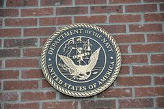 Navy of the United States Challenge Coin on brick. United States of America Department of the Navy Challenge Coin Embedded in a brick slab Stock Photo