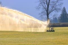 Nawozowy Rolny pole z Ciekłym nawozem zdjęcia royalty free