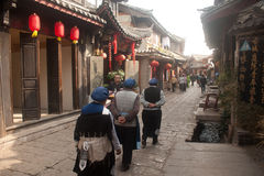 Naxi Crowd walking in Lijiang old town. Stock Images