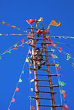 Naxi Ethnic Ladder Climbing Royalty Free Stock Photos