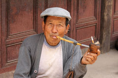 Naxi man in Lijiang Royalty Free Stock Image