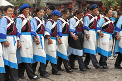 Naxi Women Dancing. Naxi ethnic minority women hold hands during their traditional dance in the central square of Lijiang in Yunnan province, China Stock Photos
