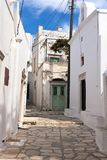 Naxos - Apeiranthos village, marble paved alleys and old white houses, Greece. Apeiranthos traditional village built on the foothill of mountain Fanari - South stock image