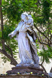 Malta, Streets of Naxxar. Sculpture of Mary with the Baby Jesus next to entrance to the church dedicated to the Nativity  of  Our  Lady in Naxxar, Malta Stock Photos