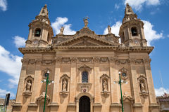 Naxxar, Malta - 2016, June 11th : The facade of the historic Our Lady of Victories parish church of Naxxar, a town in the centre o. Blue Skies, Naxxar, Malta Royalty Free Stock Image