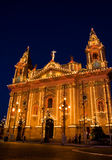 Naxxar Parish Church in festive mood. Naxxar Parish Church decorated in bright and colourful lights during celebrations of the Parish Feast - Marija Bambina Royalty Free Stock Image