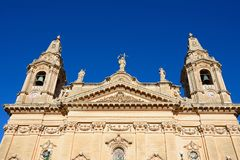 Naxxar Parish Church, Malta. View of the top of Naxxar Parish church with it`s two bell towers, Naxxar, Malta, Europe Stock Photography
