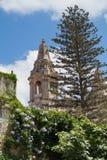 Naxxar parish church, viewed from Palazzo Parisio, Naxxar, Malta, Europe.  June 2016. Blue skies and lush gardens, Naxxar parish church, viewed from Palazzo Stock Images