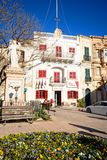 Naxxar town centre square, Malta. Statue of Madonna and child in the Pjazza Vittorja with the Red Cafe to the rear, Naxxar, Malta, Europe Stock Photos