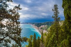 Naxxos, Sicily - Beautiful aerial landscape view of Giardini Naxxos town and beach. With turquoise sea water and pine trees in front stock photo