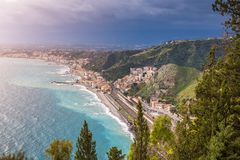 Naxxos, Sicily - Beautiful aerial landscape view of Giardini Naxxos town and beach. With turquoise sea water and trees in front Stock Image