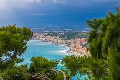 Naxxos, Sicily - Beautiful aerial landscape view of Giardini Naxxos town and beach with turquoise sea water and pine trees. In front Stock Images