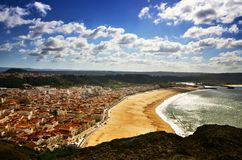 Nazaré is a popular seaside resorts in Portugal. Nazaré is one of the most popular seaside resorts in Portugal, it has long sandy beaches, considered by some Royalty Free Stock Photos