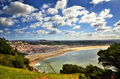 Nazaré is a popular seaside resorts in Portugal. Nazaré is one of the most popular seaside resorts in Portugal, it has long sandy beaches, considered by some Royalty Free Stock Photo