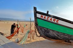 Nazaré Portugal. The beautiful fishing village of Nazaré, Portugal, is one of main ports and has a very special tradition in fish, expecially shellfish royalty free stock photo