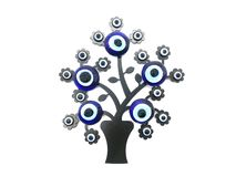 Nazar, charms to ward off the evil eye , on the branches of a tree. Isolated white background. Turkish decorative amulet for. Protection. Magic symbol. Talisman royalty free stock photography