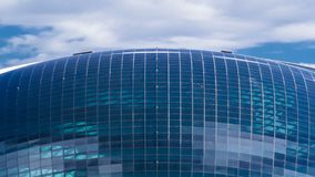Nazarbayevcentrum en blauwe toren, met wolken ond bezinning Astana, Kazachstan stock video
