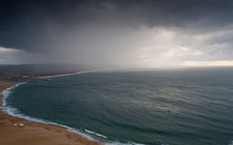 Nazare beach in a stormy day Stock Photos