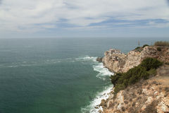 Nazare, Cliff and Lighthouse in Portugal Stock Photo