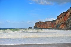 Nazare lightouse and cliffs on stormy day stock photo