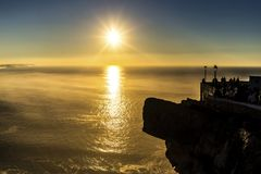 Nazare ocean canyon viewpoint sunset and mist royalty free stock images