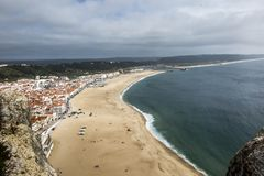 Nazare is one of the most popular seaside resorts in Portugal, c. Onsidered by some to be among the best beaches in Portugal. The neighbourhoods are linked by a stock images