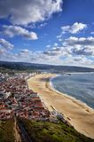 Nazare is a popular seaside resorts in Portugal. Nazare is one of the most popular seaside resorts in Portugal, considered by some to be among the best beaches Stock Photography