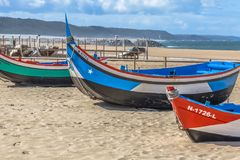 Detailed view of colored and traditional fishing boats on the Nazare beach royalty free stock image
