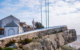 Cliff and legend. Nazare, Portugal - March 5, 2019 : Sitio da Nazare Cliff and little chapel in honor to Our Lady of Nazareth due to Dom Fuas Roupinho Legend, at royalty free stock photo