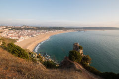 Nazare town at the sunset. You can see the coast of Atlantic Ocean and the town of Nazare Royalty Free Stock Photo