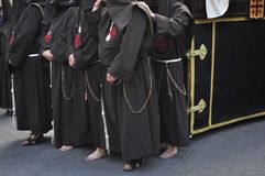 Nazarene barefoot on the cobblestone floor. royalty free stock images