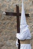 Nazarene carrying a heavy cross. Stock Photo
